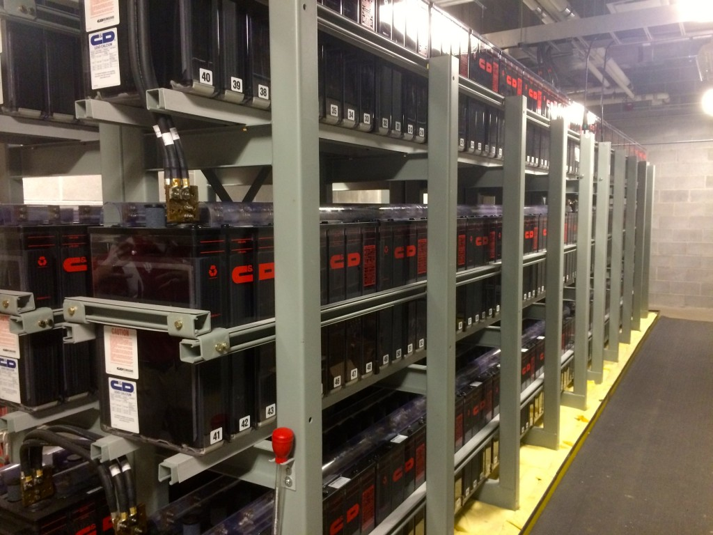 This room contains a lot of lead acid backup batteries, as you can see. While the critical systems would switch to the generators in a time of emergency, non-critical servers would switch over to these. This then gives the IT staff time to save everything and shut things down properly