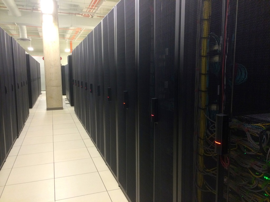 Here is a row of servers provided by clients which are colocated to the Data Center. There servers contain sensitive data, so they can only be accessed by the client using the RFID locks on each rack (the red lights).